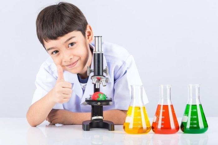 kids working on microscope